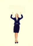 Beautiful business woman holding empty board. Royalty Free Stock Images
