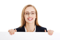 Beautiful business woman holding empty board, copy space. Royalty Free Stock Image
