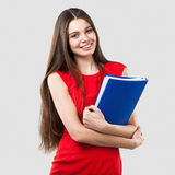 Beautiful business woman holding folder Stock Images
