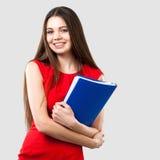 Beautiful business woman holding folder Stock Photos