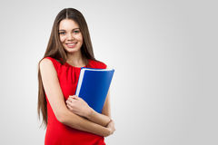 Beautiful business woman holding folder Royalty Free Stock Images