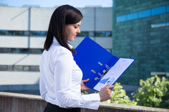 Beautiful business woman holding folder with business plan Royalty Free Stock Photo