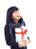 Beautiful business woman holding a gift Royalty Free Stock Photos