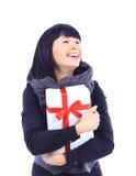 Beautiful business woman holding a gift Stock Photo