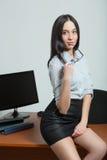 Beautiful business woman holding glasses Stock Image