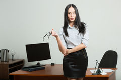 Beautiful business woman holding glasses Royalty Free Stock Photo