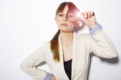 Beautiful business woman holding magnifying glass Stock Image