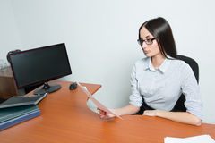 Beautiful business woman holding a paper. Stock Photography