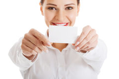 Beautiful business woman holding personal card. Royalty Free Stock Photo