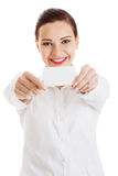 Beautiful business woman holding personal card. Royalty Free Stock Image