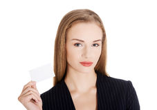 Beautiful business woman holding small empty personal card. Royalty Free Stock Photo
