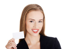 Beautiful business woman holding small empty personal card. Royalty Free Stock Images