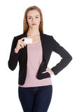 Beautiful business woman holding small empty personal card. Stock Image