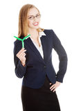 Beautiful business woman holding small green propeller. Stock Photo