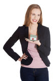 Beautiful business woman holding small house on palm. Royalty Free Stock Photo