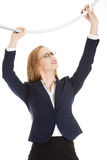 Beautiful business woman holding sth heavy above her. Stock Photography