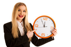 Beautiful business woman holds a clock as a sign for time manage Royalty Free Stock Photography