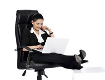 Beautiful Business Woman on a Laptop Royalty Free Stock Image