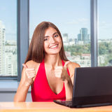 Beautiful business woman with laptop in office Royalty Free Stock Photography
