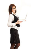 Beautiful business woman with a laptop. Standing on a white background Royalty Free Stock Images