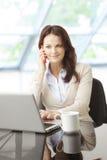 Beautiful business woman with laptop Stock Photo