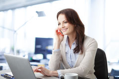 Beautiful business woman with laptop Royalty Free Stock Image