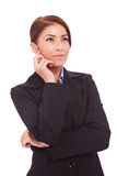Beautiful business woman looking contemplative. Portrait of young beautiful business woman looking contemplative to her side. Isolated over white stock images