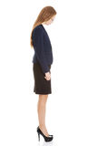 Beautiful business woman looking down. Side view. Stock Photos