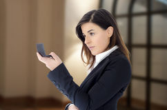 Beautiful business woman looking in the mirror in the hand Royalty Free Stock Photos