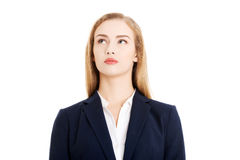 Beautiful business woman looking up at copy space. Stock Image