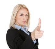 Beautiful business woman making a gun gesture Stock Image