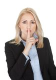 Beautiful business woman making a silence gesture. Isolated on white Royalty Free Stock Image