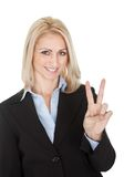 Beautiful business woman making a victory gesture Royalty Free Stock Images