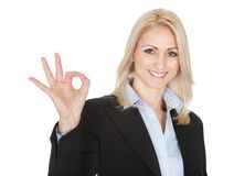 Beautiful business woman making a victory gesture Stock Photo
