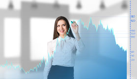 Beautiful business woman near with big graph Royalty Free Stock Photo