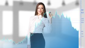 Beautiful business woman near with big graph Stock Photo