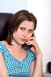 Beautiful business woman in an office Royalty Free Stock Photo