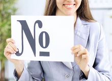 Beautiful business woman in office holding a sign with the number sign Royalty Free Stock Photos