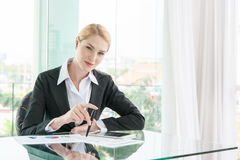 Beautiful business woman in office Royalty Free Stock Image