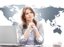 Beautiful business woman in the  office on a world map backgroun Royalty Free Stock Image