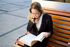 Beautiful business woman outside her office Stock Images