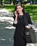 Beautiful business woman in the park Stock Photography