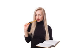 Beautiful business woman with pencil and notepad thinking Royalty Free Stock Images