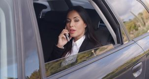 Beautiful business woman on phone in automobile stock footage