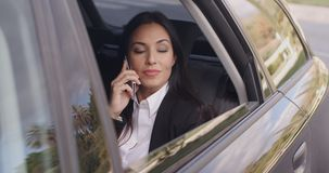 Beautiful business woman on phone in automobile stock video footage
