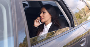 Beautiful business woman on phone in automobile Royalty Free Stock Images
