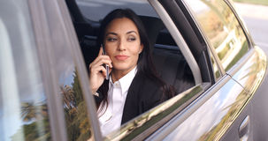 Beautiful business woman on phone in automobile Stock Images