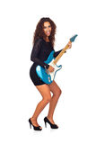 Beautiful Business Woman Playing Electric Guitar Royalty Free Stock Photography