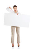 Beautiful business woman pointing on copy space. Stock Photo