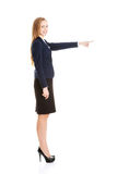 Beautiful business woman pointing on copy space. Stock Image